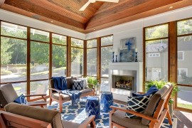 Cool cottage chic beach style sunroom with a splash of blue
