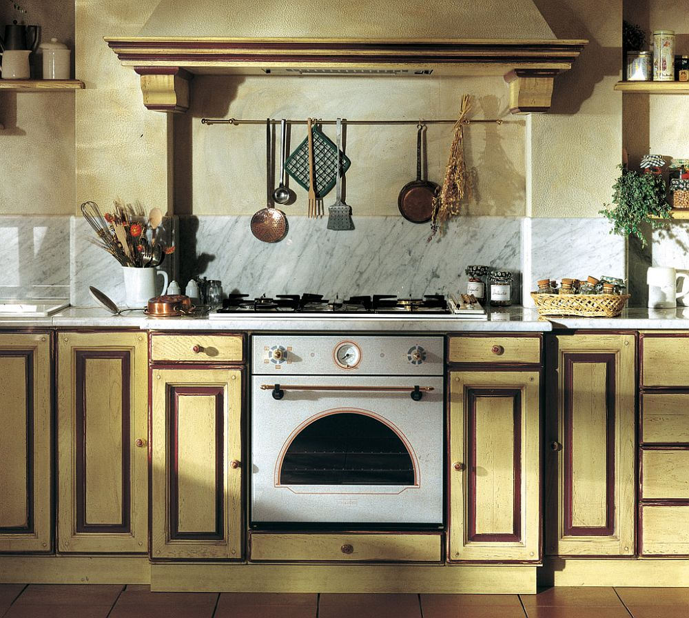 Country style Granduca kitchen with custom cabinetry and marble backsplash