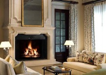 Cozy fireplace and conversation nook in the luxurious bedroom