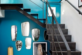 Curated mirror display under the staircase