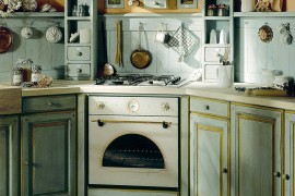 Custom cabinetry and stone or marble tiles worktops draw inspiration from Mediterranean kitchens