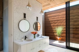 Custom floating vanity and sink for the contemporary master bathroom