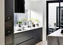 Dark-cabinets-add-contrast-to-the-white-kitchen-with-a-gorgeou-marble-island-217x155