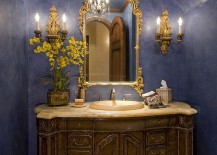 Dashing powder room in bright blue and a dash of gold
