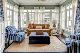 Decor in blue and white is perfect for the beach style sunroom
