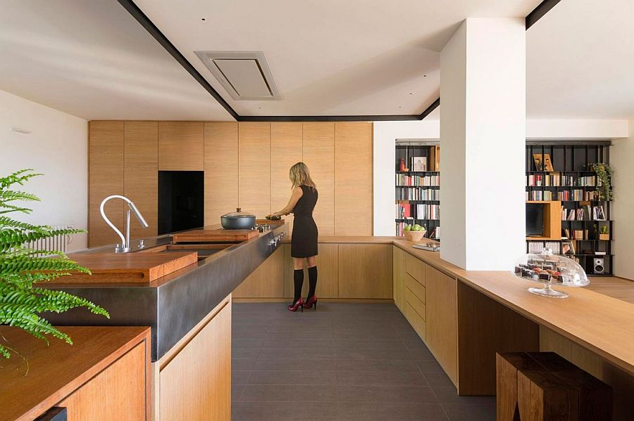 Design of the kitchen separates it from the living room in a distinct, visual fashion