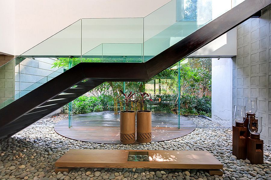 Design of the staircase allows it to become a part of the landscape around the house