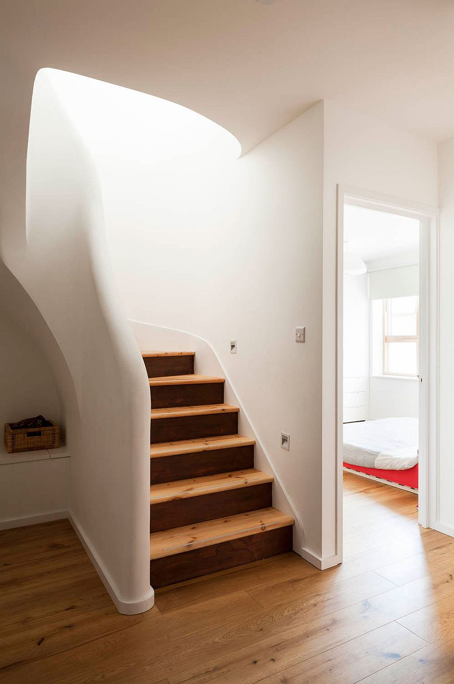 Design of the staircase and rootop terrace brings a flood of light into the lower level as well
