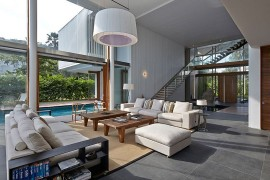 Double-height contemporary living room connected with the pool deck