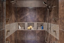 Earth-toned shower with more than one shower head