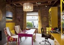 Eclectic home office with exposed brick walls and full of color and creativity