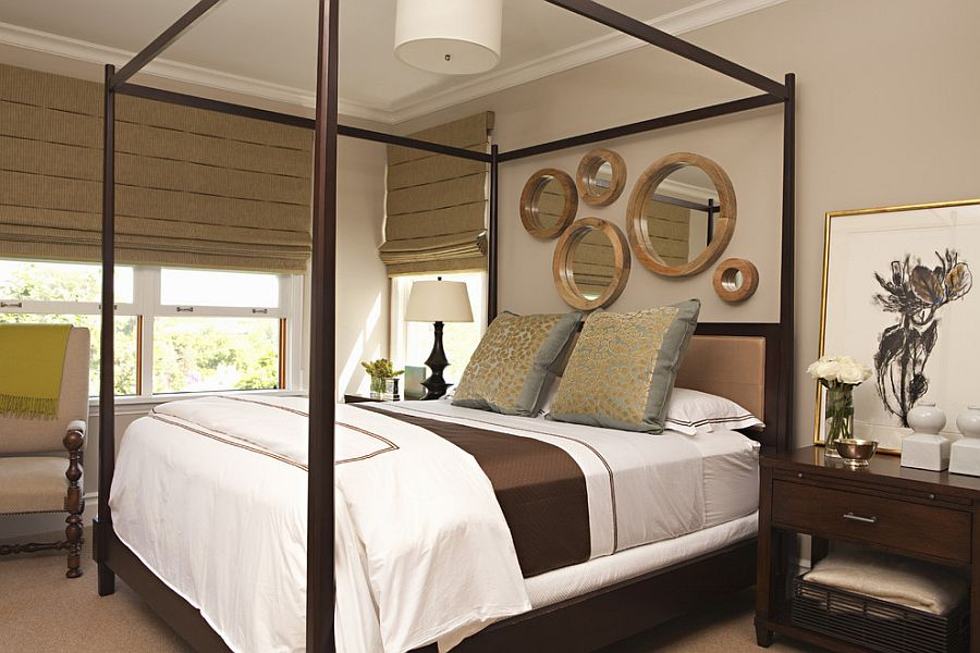 Elegant way to spice up the headboard wall in the bedroom with mirrors [Design: Tim Barber Ltd Architecture]