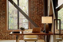 Exposed brick wall backdrop is perfect for the industrial home office