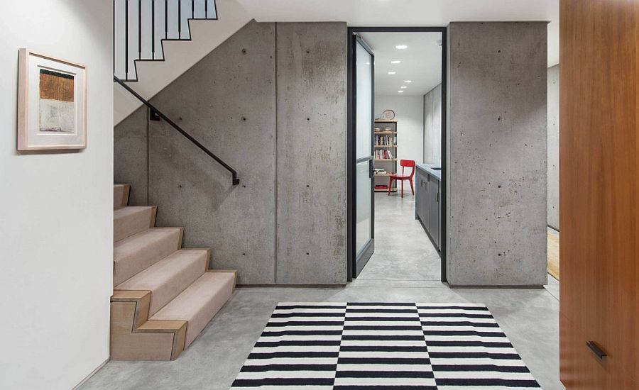 Exposed concrete walls give the interior an edgy, modern look
