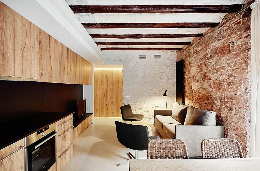 Exposed original walls of the apartments take you back in time Holiday apartments in Borne: Barcelona's Rich Heritage Repackaged in Style