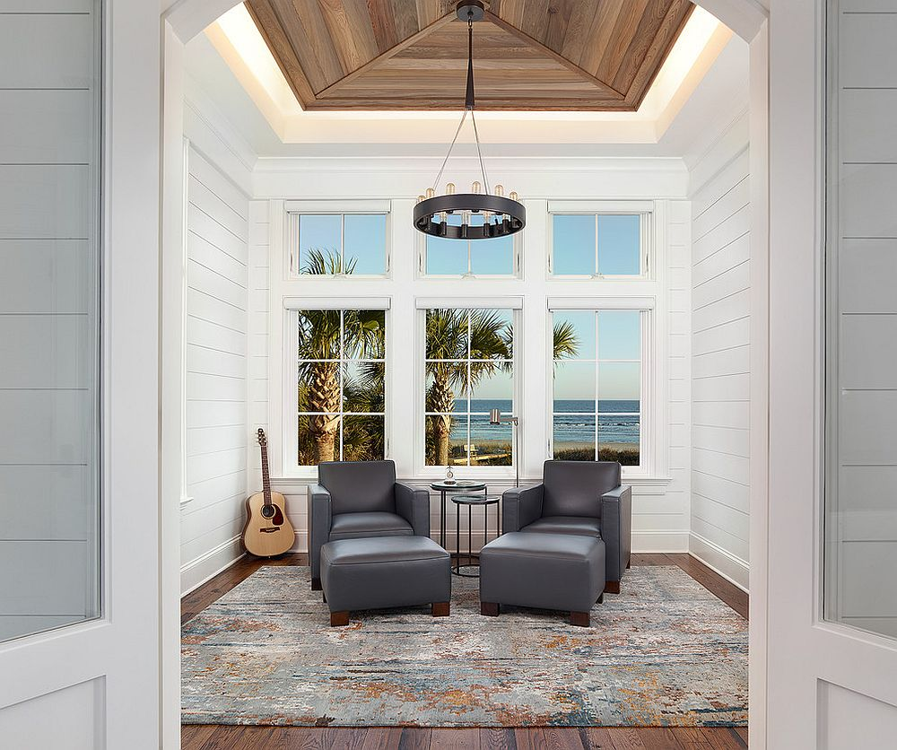 Exquisite beach style sunroom borrows from clean lines of contemporary design [Design: Amy Trowman Design]