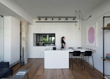 Extended kitchen island acts as a cool dining table and also helps demarcate space
