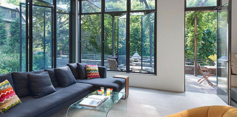 Extensive and fun use of glass windows opens up the interior of the classic home