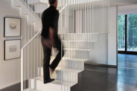 Fabulous and stylish staircase design supported by metal rods