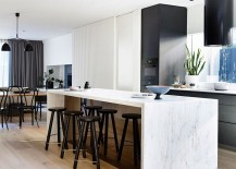 Fabulous marble kitchen island with dark bar stools steals the show