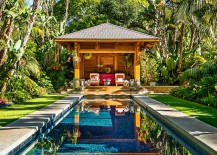 Fabulous tropical pool house and pool surrounded by lush tropical vegetation