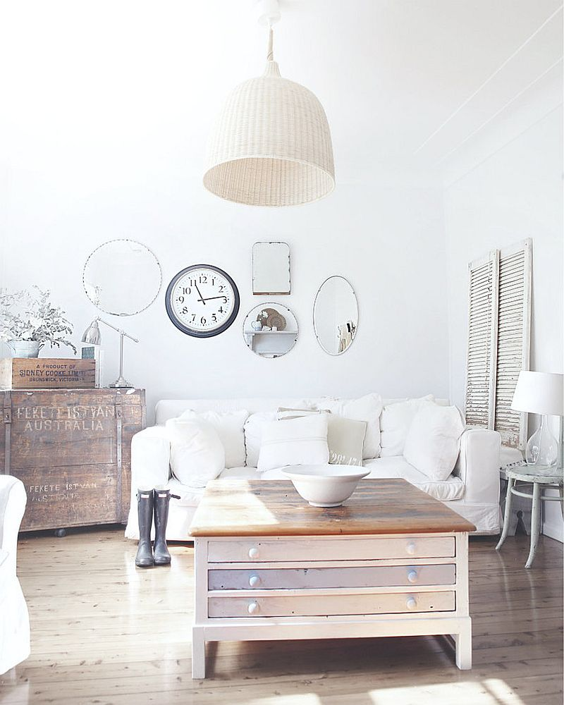 Finish of the clock lets it blend in with the mirror collection [Design: A Beach Cottage]