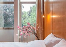 Flowers bring freshness and visual softness to the bedroom
