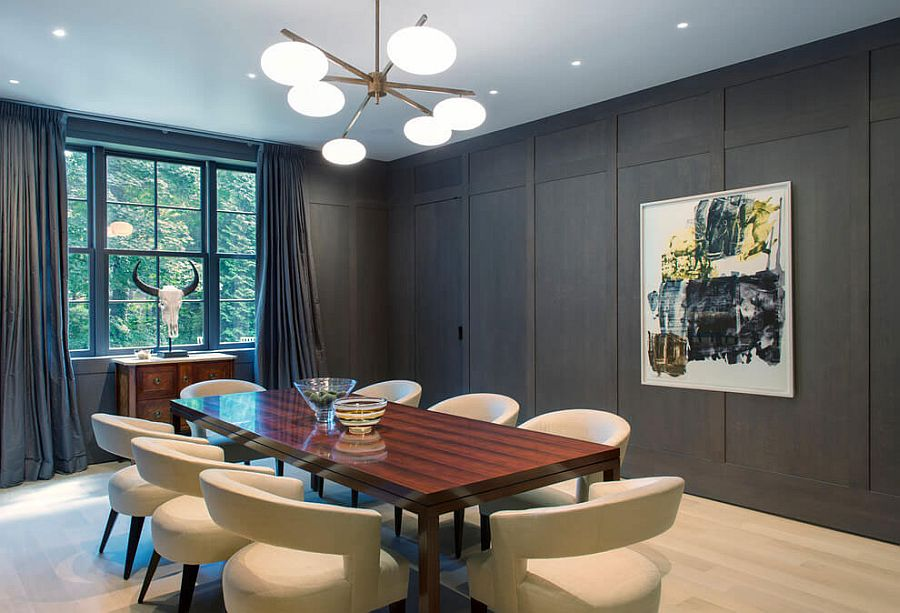 Formal dining room with dark walls, drapes and comfy, white chairs