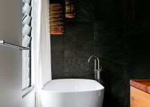 Freestanding-bathtub-in-white-set-against-a-dark-backdrop-217x155