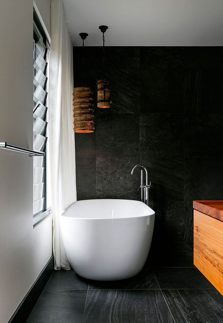 Freestanding bathtub in white set against a dark backdrop