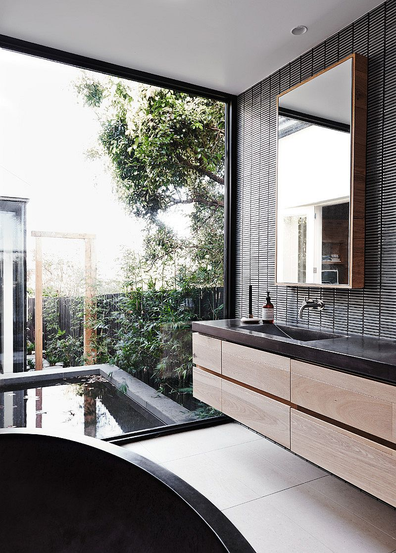 Glass wall connects the powder room with the landscape outside