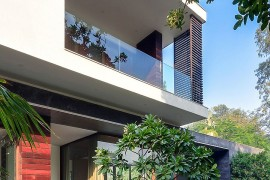 Glass walls and fabulous landscape around the house give it an open, natural look
