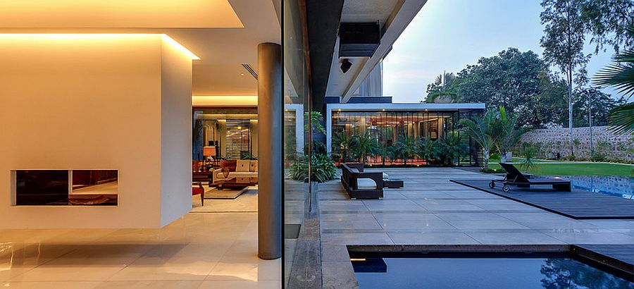 Glass walls blur the line between the pool area and living space
