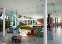 Glass-walls-completely-open-up-the-interior-to-the-landscape-outside-217x155