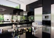 Glozzy black cabinets and glazed, black kitchen worktop for the modern minimalist kitchen