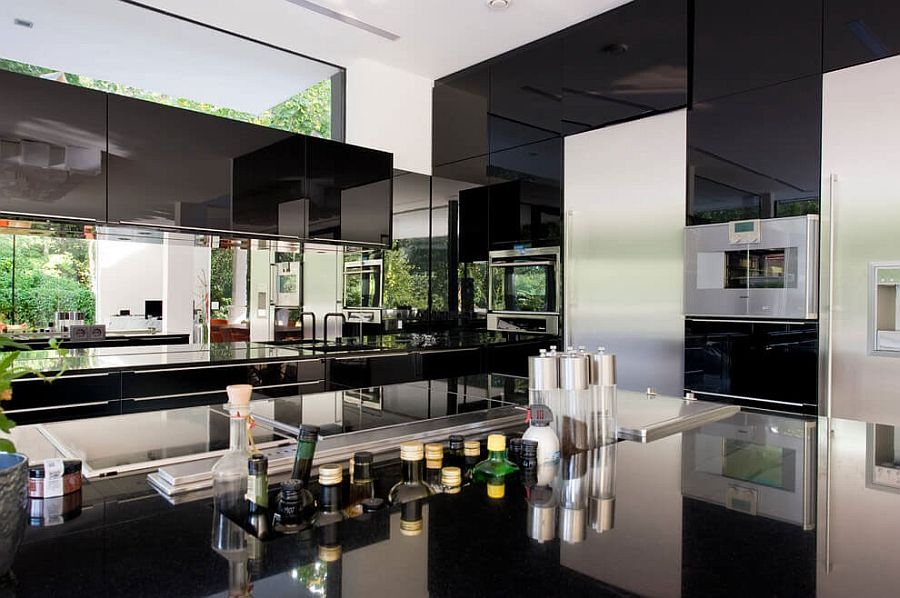 Glozzy black cabinets and glazed, black kitchen worktop for the modern minimalist kitchen