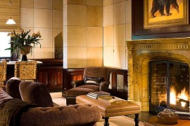 Gold and black creates brings an air of opulence in the family room