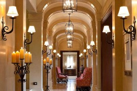 Grand hallway design with fabulous sconce and pendant lighting