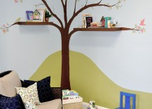 Hand-painted tree and cool shelves create a fun reading zone in the kids' room