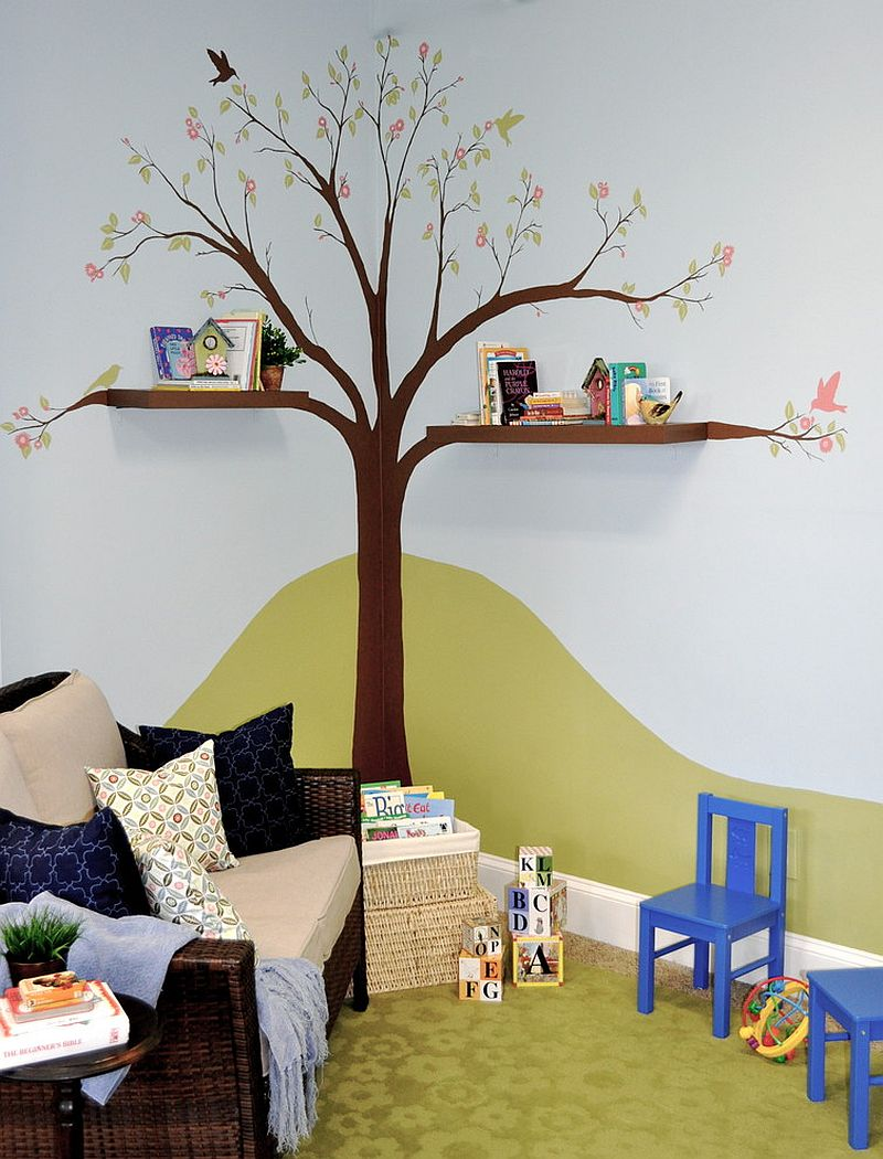 Hand-painted tree and cool shelves create a fun reading zone in the kids' room [Design: Alicia Ventura Interior Design]