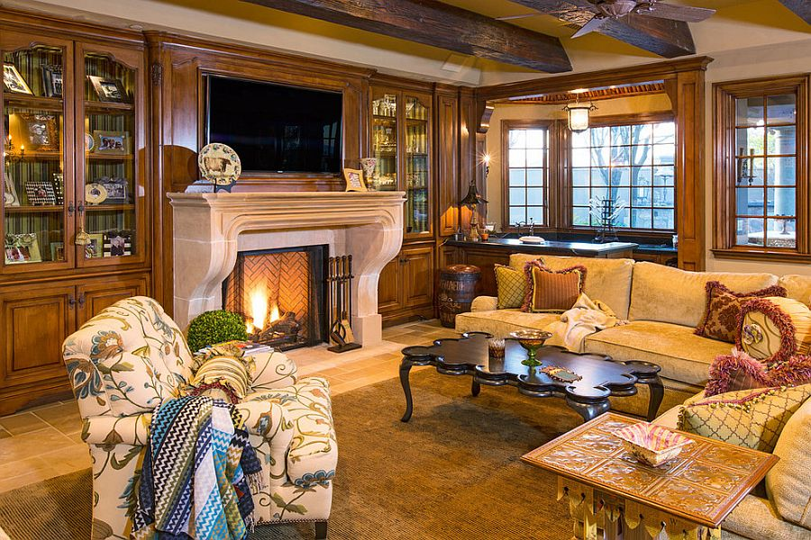 Herringbone pattern fireplace and exposed wooden ceiling beams in the living room [Design: Taylor House Interiors]