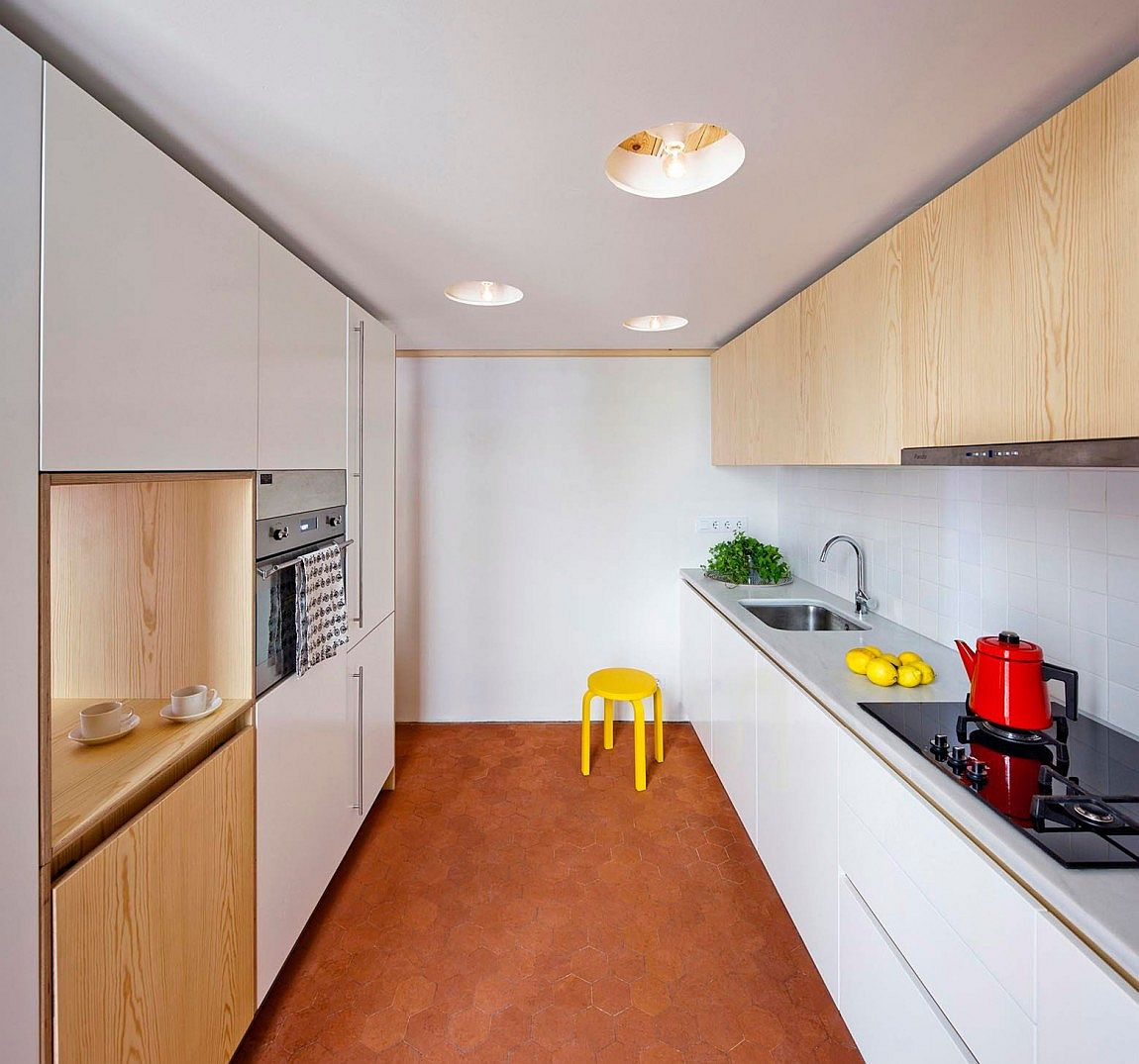Hexagonal floor tiles stand out in the innovative and space-savvy kitchen