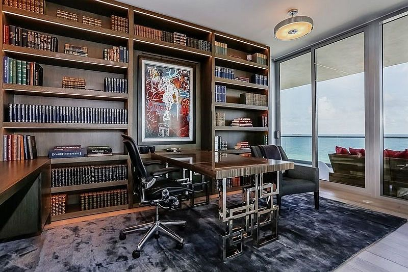 Home office with open bookshelves and ocean views