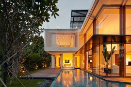 Interior of the No 2 home in Singapore flows into the ponds and pool area outside