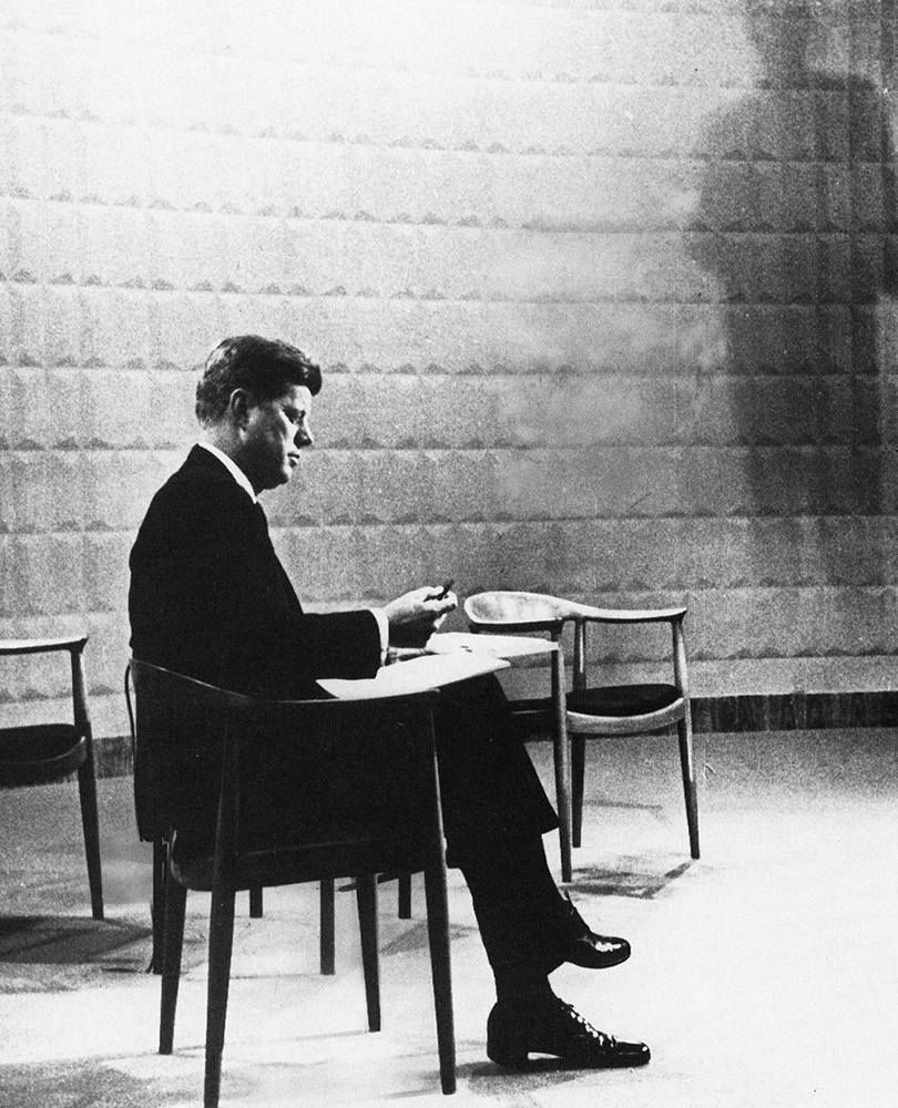 John F Kennedy seated in The Chair