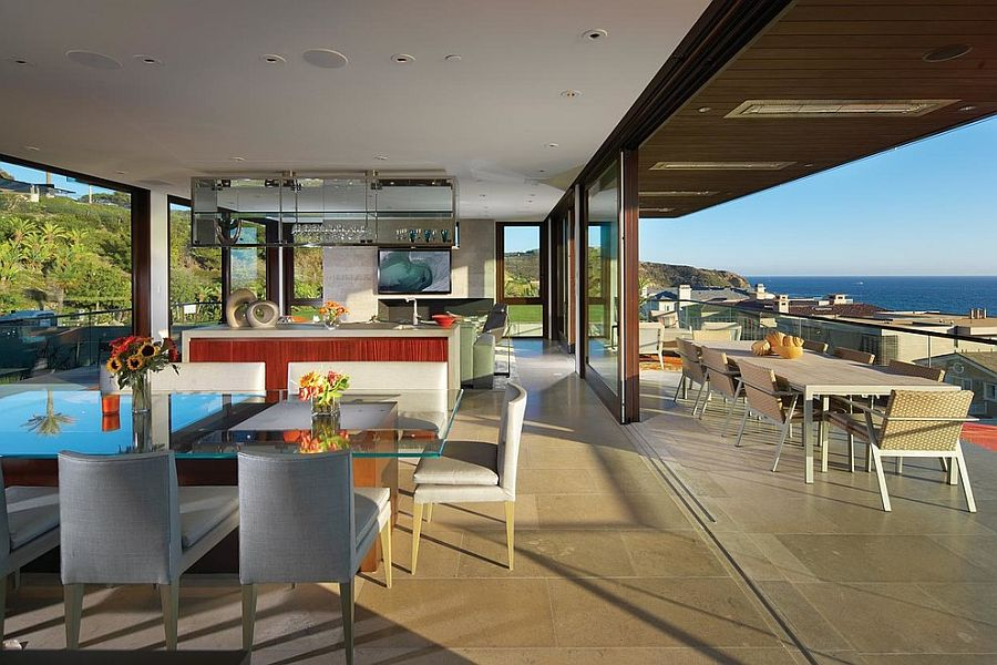 Kitchen that opens up to the deck with ocean view becomes the heart of the social zone [Design: Horst Architects]