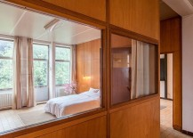 Large glass windows connect the bedroom with the open living space