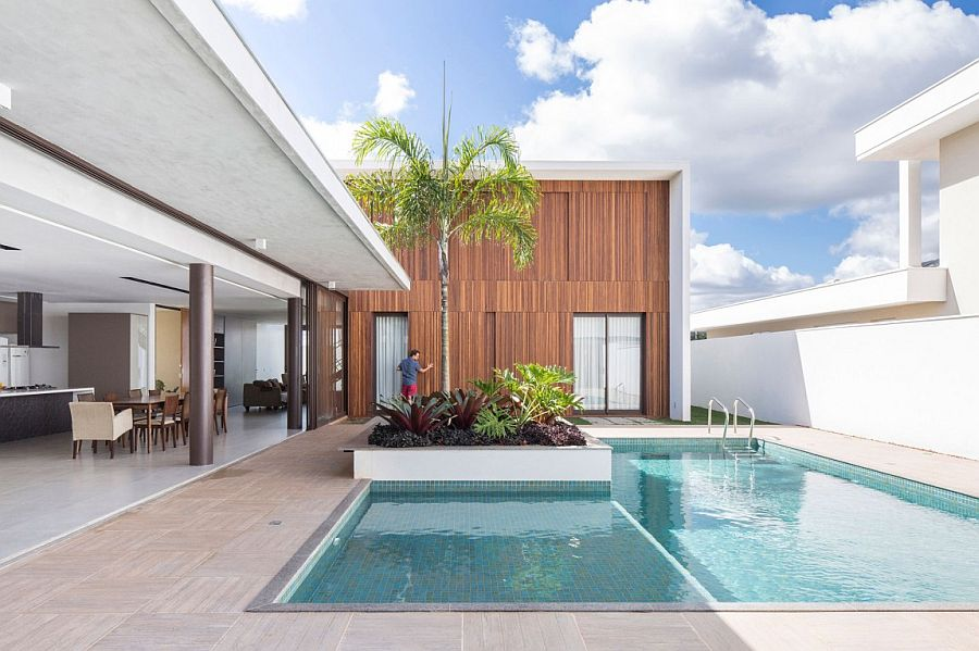 Large moving wooden panels of the structure overlooking the pool area