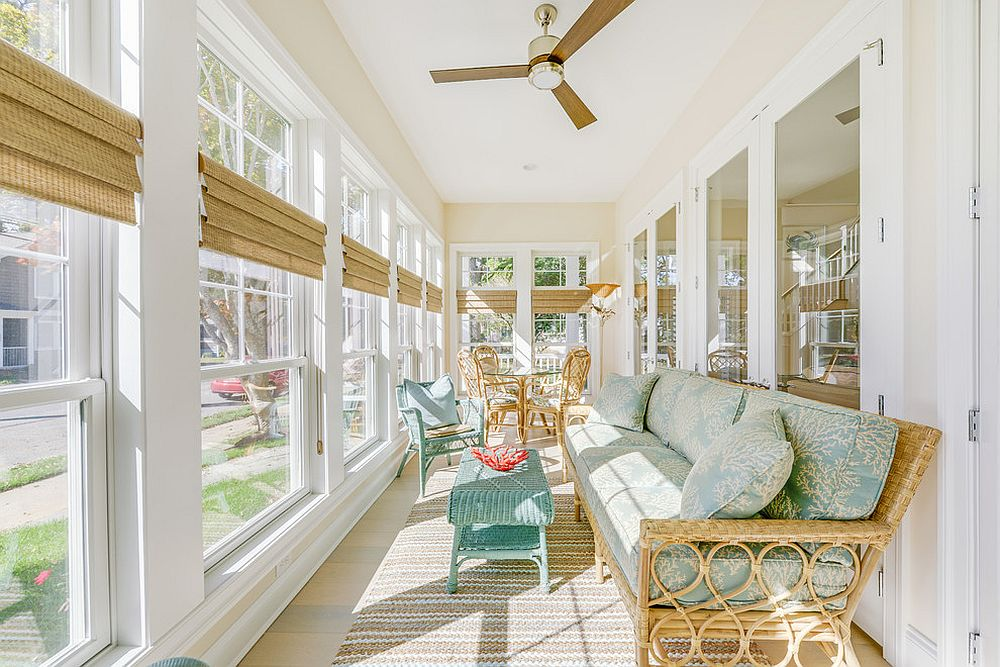 Large porch with windows turned into an elegant sunroom [Design: Echelon Interiors]