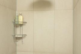 Large shower head in a tiled shower